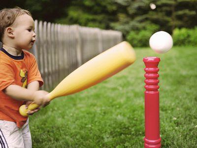 toddler boy playing tee-ball