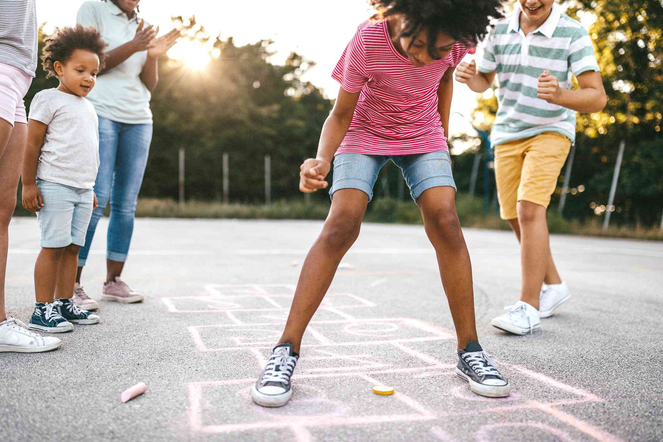 A family playing hopscotch