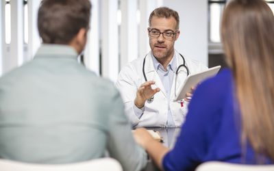 Doctor speaking to couple