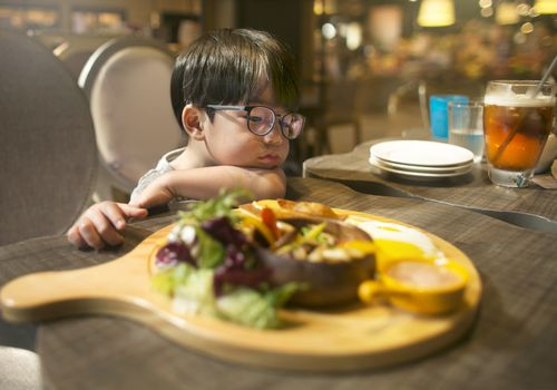 little boy doesn't want to try the food