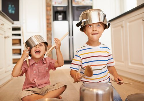 children with pots and pans on their heads