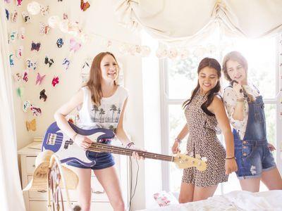 Girls playing guitar and singing