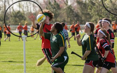 Kids playing quidditch