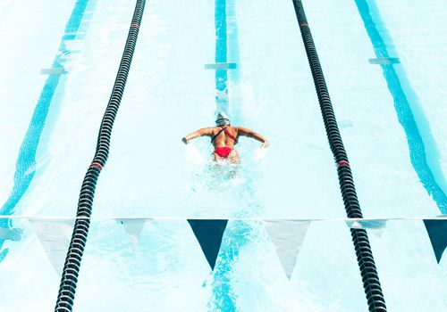 olympic swimmer doing butterfly stroke