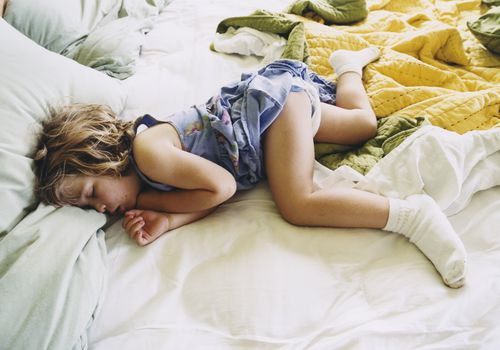 Toddler Sleeping on Bed