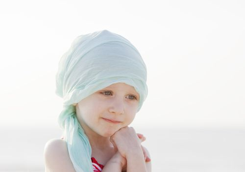 child in a head scarf