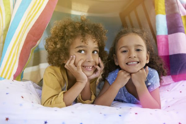 pretend play ideas - kids in a fort indoors