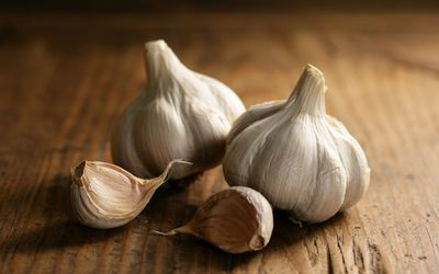 Bulbs of garlic on a wooden surface