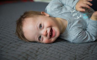 Cute baby boy with Down syndrome