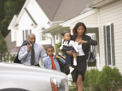 mother, father and kids on the way to work