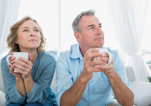 mature parents looking thoughtful