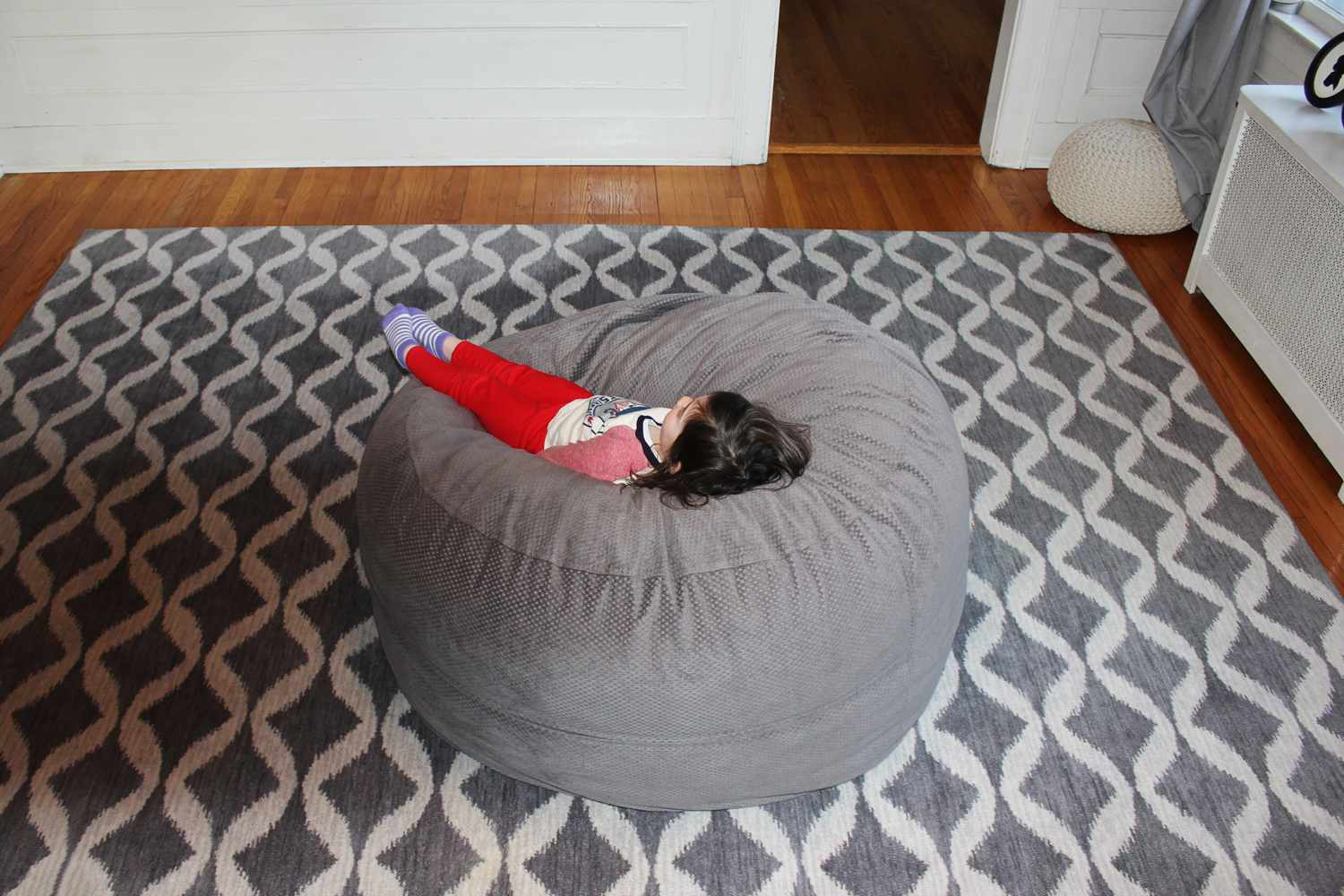 CordaRoy bean bag chair with child sitting