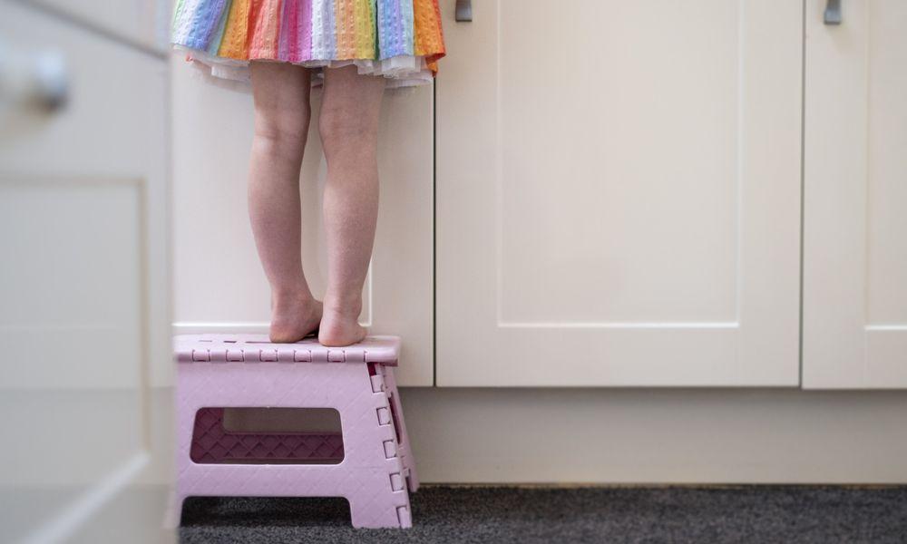 Child on step stool