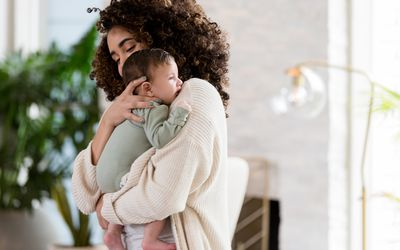 A mom holding her newborn