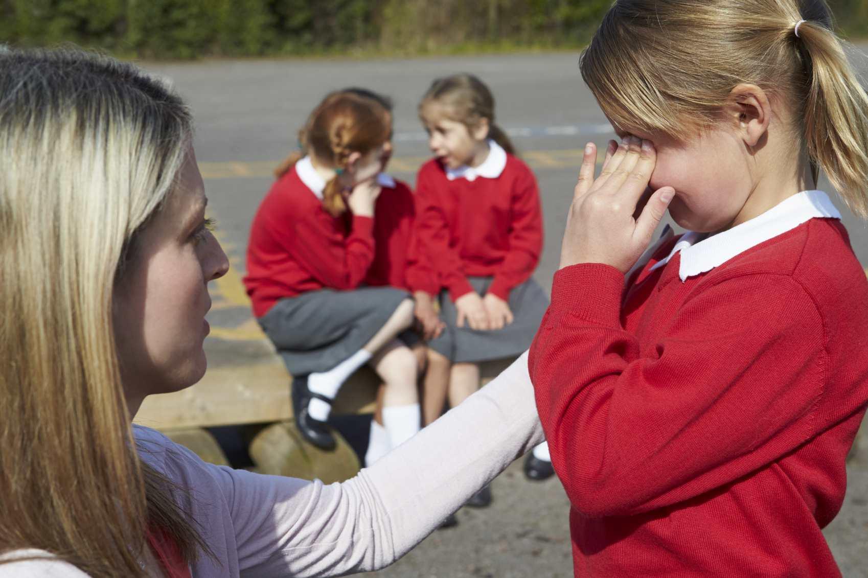 teacher comforting a student