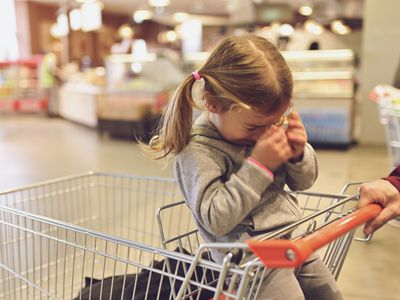 Child Having Argument With Parent in Store