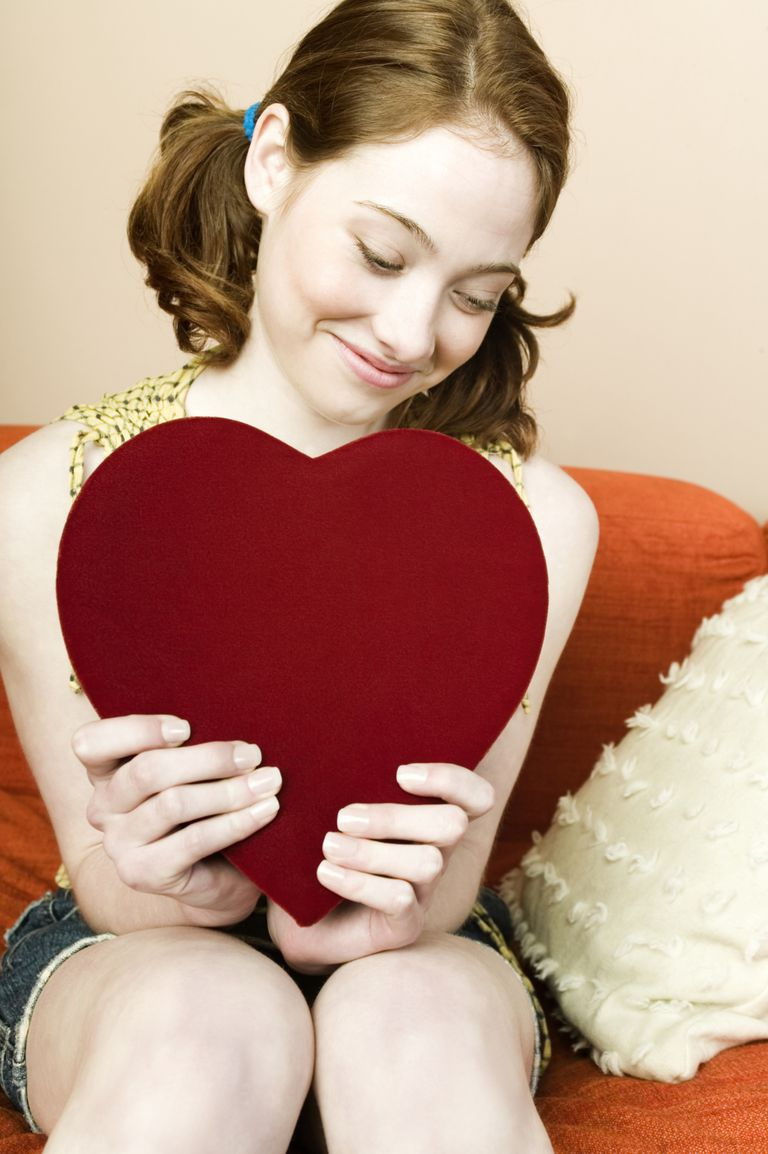 teenager holding heart shaped box