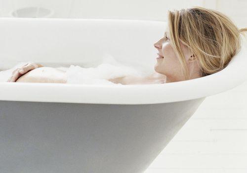 pregnant woman taking a bath