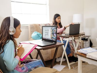 girls doing homeschool work