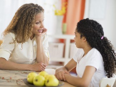 Mother talking with daughter