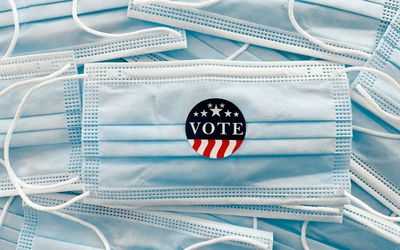 Disposable masks with vote sticker on the front