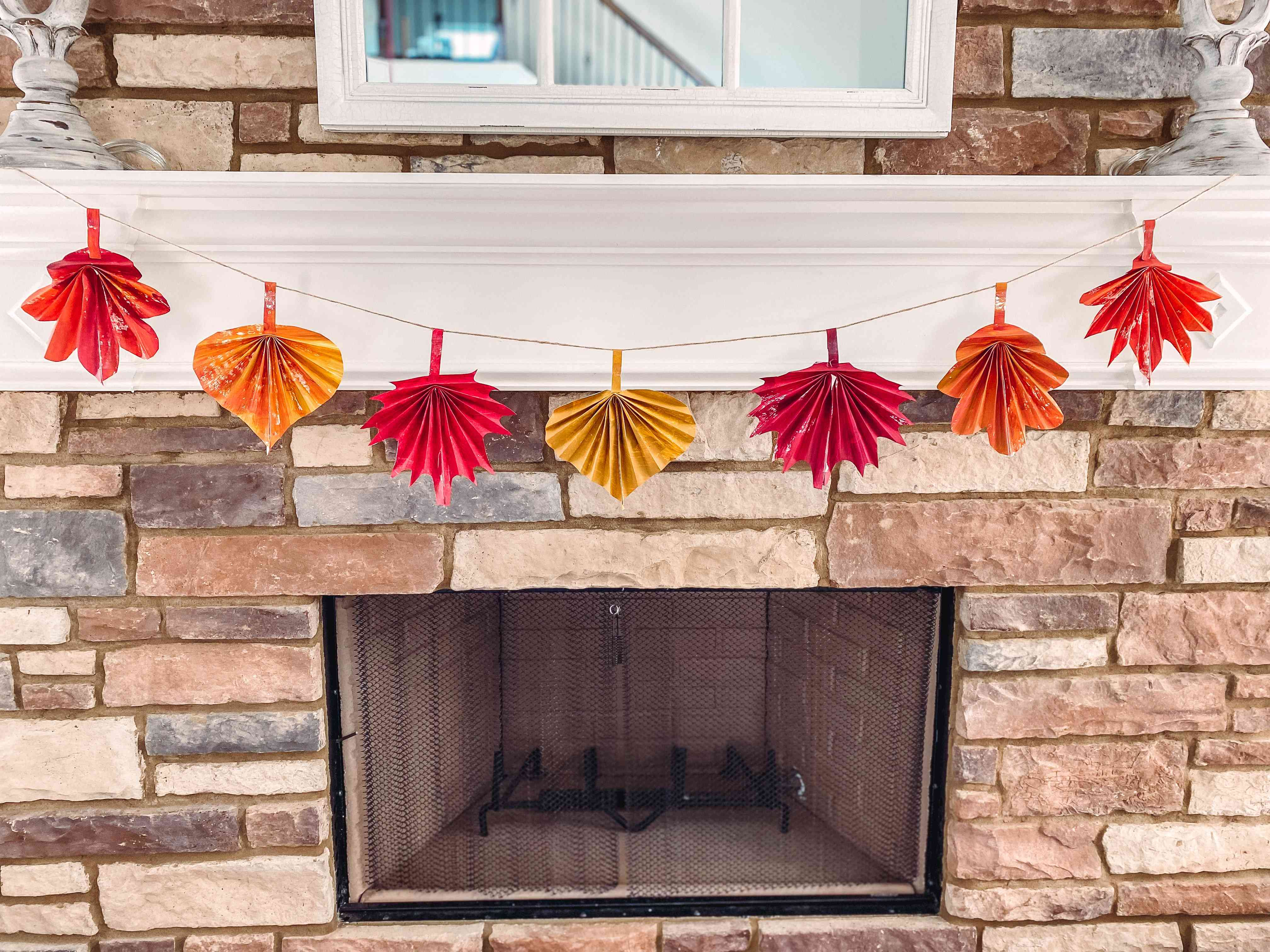 Fall leaf garland over a fireplace