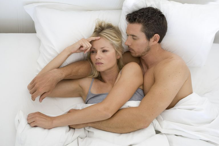 Couple in bed worried they are infertile