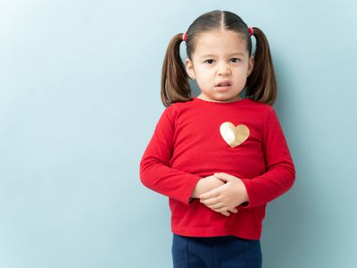 Young girl holding stomach