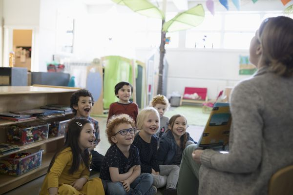 Teacher reading to a group of children