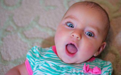 Overhead portrait of wide eyed baby girl