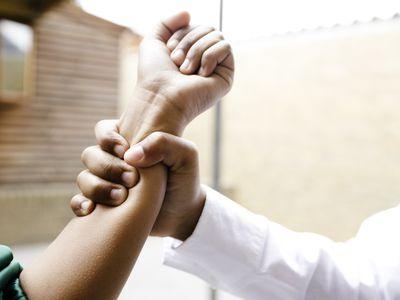 School boy grabs girls arm
