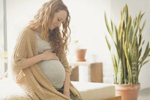 Pregnant woman holding stomach