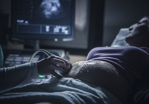 Pregnant woman having sonogram