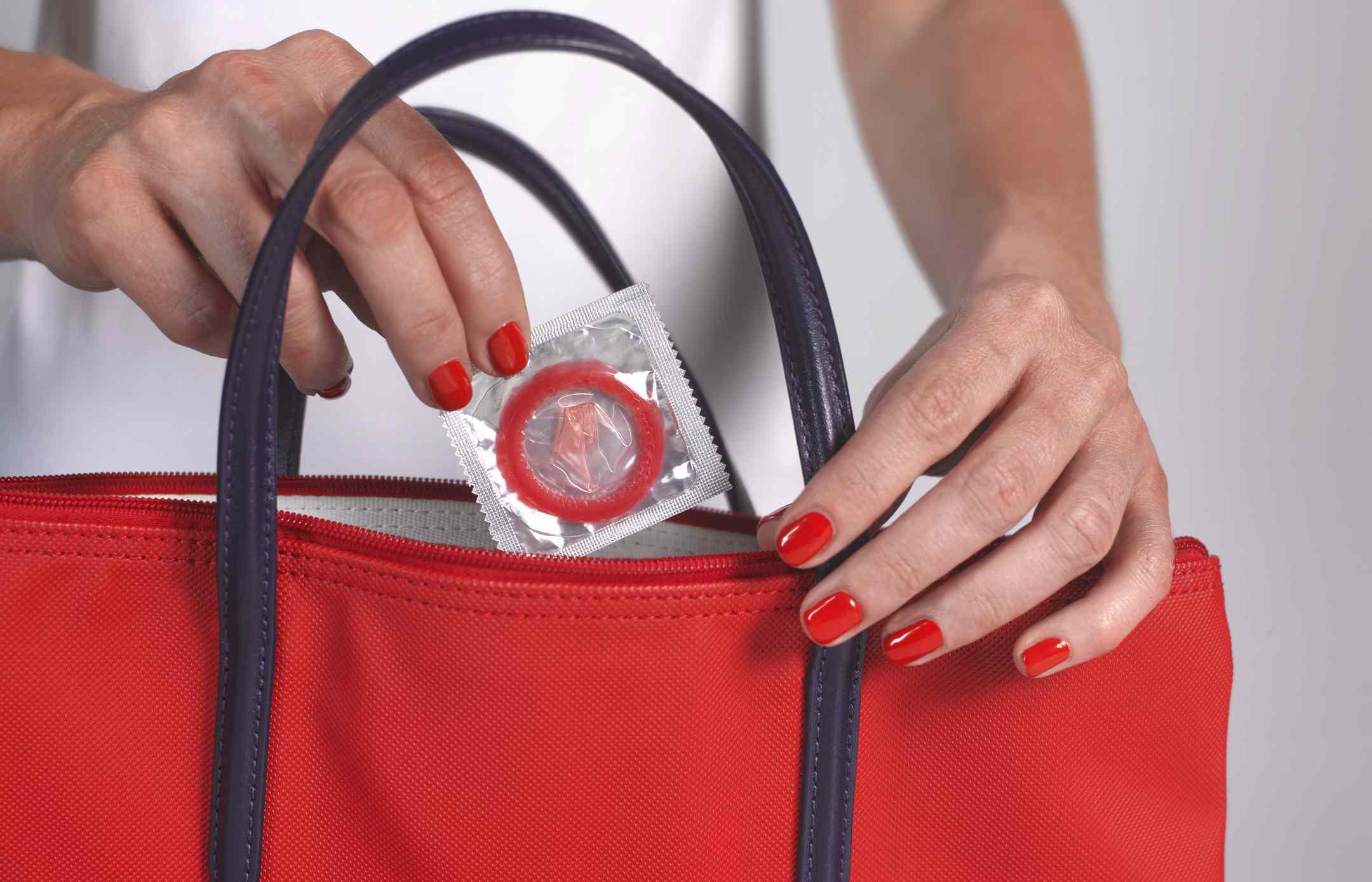 Strawberry condom in handbag