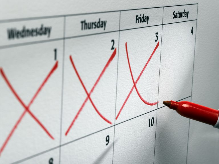 Photo of three red x marks on days of a calendar