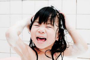 child washing hair