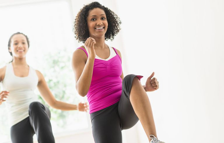 Two women working out together to improve their health and fertility
