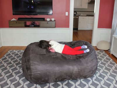 three post bean bag chair with child laying down