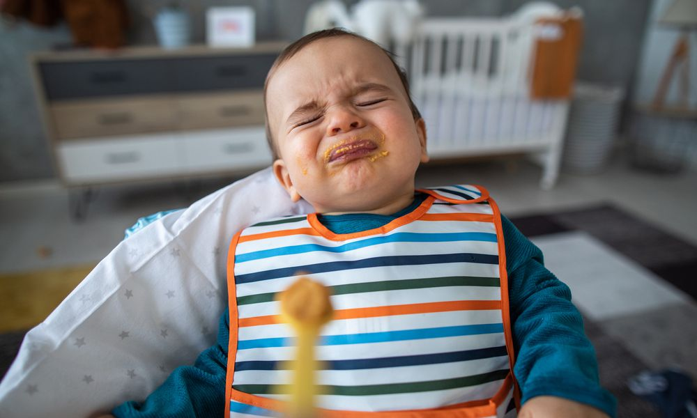 Angry toddler spitting up food