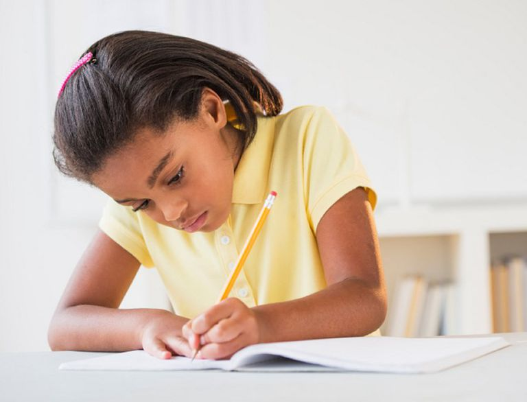 Young girl writing a biography