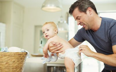 Father checking baby's diaper