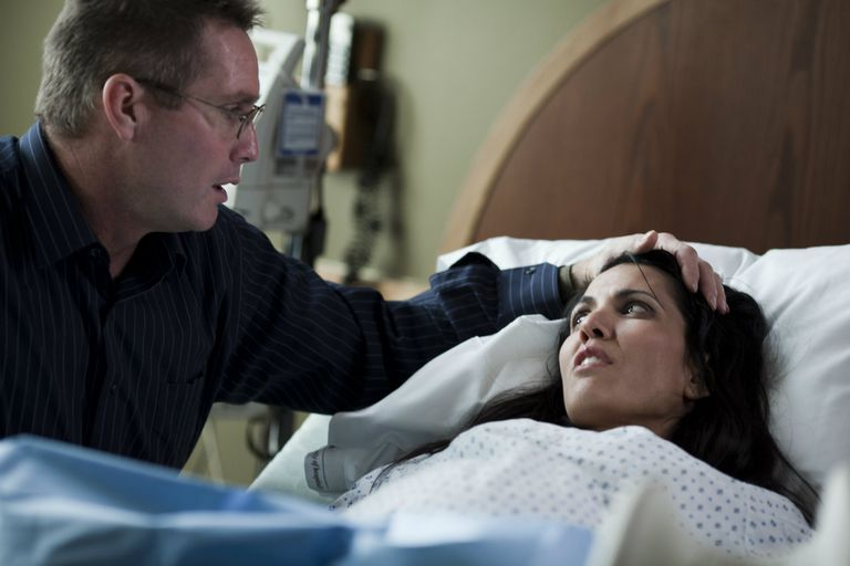 Man comforting woman giving birth