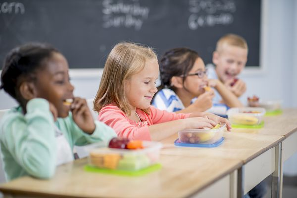 Students Eating Snacks at School - stock photo