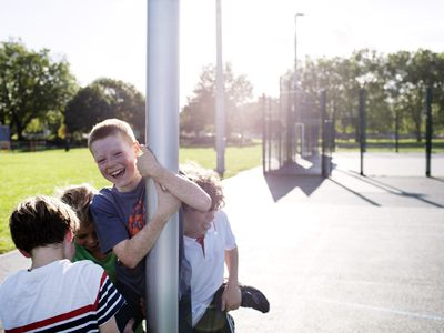 Boys playing outside in the park
