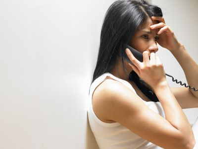 Woman on the phone, anxious