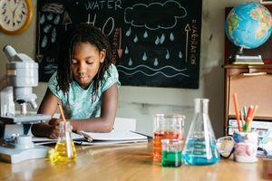 Girl working in chem lab at school