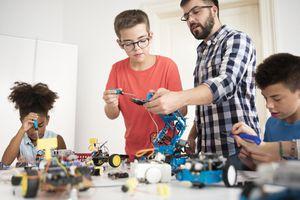 Kids working on robotics STEM project