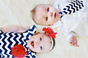 Dizygotic twins in matching outfits, a baby boy and a girl