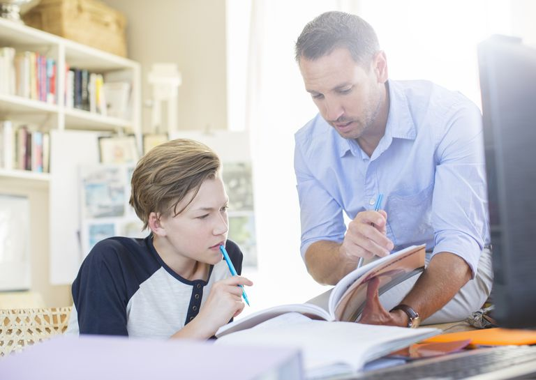 Father helping son with schoolwork