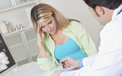 Concerned patient being shown test results from doctor